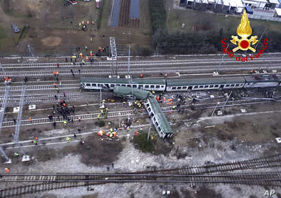 An aerial view shows a derailed train at the station of Pioltello Limito, on the outskirts of Milan, Italy, Jan. 25, 2018.