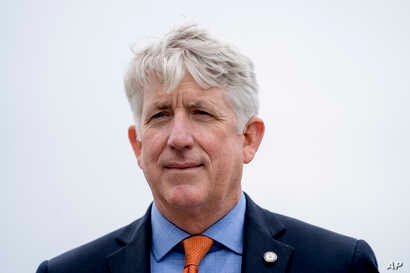 FILE - Virginia Attorney General Mark Herring attends a news conference near the White House, Feb. 26, 2018 in Washington.