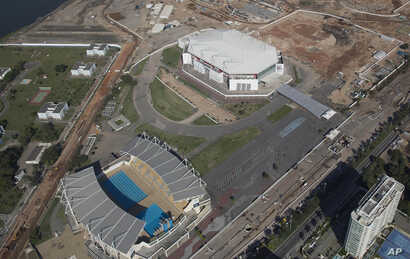 FILE - The Olympic Arena, top, and the Maria Lenk Aquatics Center under construction in Rio de Janeiro, Brazil, June 27, 2014. International sports federations expressed concern Tuesday over problems with venues for the summer Olympics.