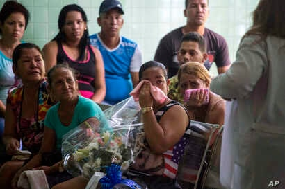Grieving relatives of passengers who perished in Cuba's worst aviation disaster wait at the morgue for the identification of the bodies in Havana, Cuba, May 20, 2018.
