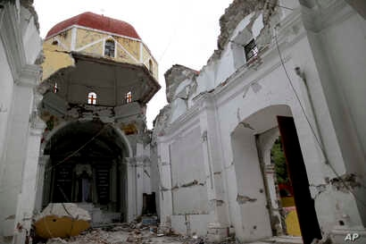 Santiago Apostol church was destroyed during the recent 7.1-magnitude earthquake, in Atzala, Mexico, Sept. 23, 2017.