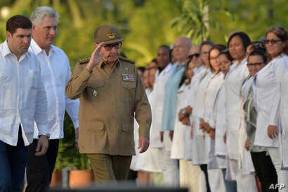 The First Secretary of Cuba's Communist Party Raul Castro (C) and President Miguel Diaz-Canel (2nd-L) arrive at the Santa Ifigenia Cemetery in Santiago de Cuba, Jan. 1, 2019, to celebrate the 60th anniversary of the revolution.