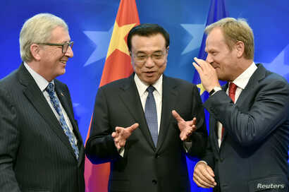 FILE - European Commission President Jean-Claude Juncker, left,Chinese Premier Li Keqiang, center, and European Council President Donald Tusk attend a signing ceremony during a EU-China summit in Brussels, June 29, 2015. The three will meet Friday to...