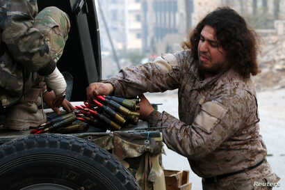 A Free Syrian Army fighter handles ammunition in a rebel-held area of Aleppo, Syria, Dec. 12, 2016.