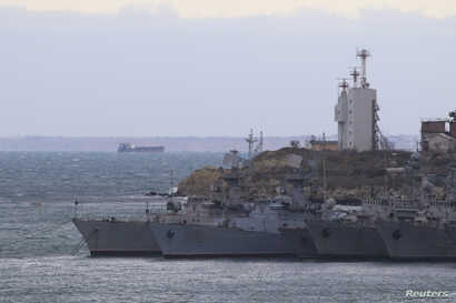 FILE - Warships of Ukrainian navy's, which remained in Crimea after it was annexed by Russia from Ukraine in 2014, moor at Streletskaya Bay in the Black Sea port of Sevastopol, Crimea, Jan. 13, 2018.