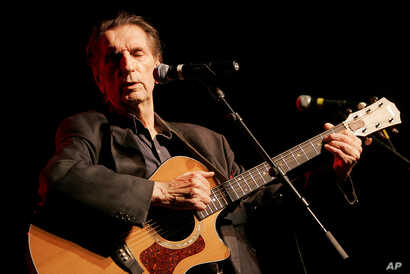 FILE - Actor Harry Dean Stanton performs at the 35th anniversary celebration of the founding of Greenpeace in Los Angeles, Sept. 9, 2006.