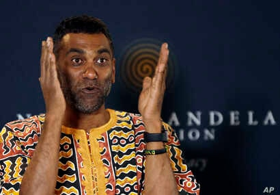 Kumi Naidoo, Secretary General of Amnesty International, gestures while speaking during a news conference at the Nelson Mandela Foundation in Johannesburg, South Africa, Aug. 16, 2018.