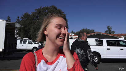 Caila Sanford survived the mass shooting during a Las Vegas concert last year. She never expected there would be a mass shooting so close to her home in California. She's now afraid of going to places with a lot of people. (E. Lee/VOA)