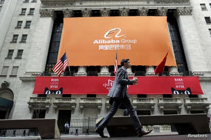 FILE - Signage for Alibaba Group Holding Ltd. covers the front facade of the New York Stock Exchange, in Manhattan.