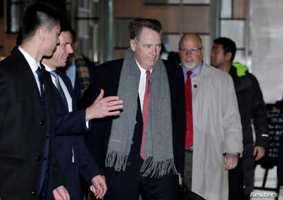 U.S. trade representative Robert Lighthizer, center, a member of the U.S. trade delegation to China, arrives at a hotel in Beijing, China, Feb. 12, 2019.