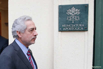 FILE - Chilean prosecutor Raul Guzman is seen after a meeting with special Vatican envoys Archbishop Charles Scicluna and Father Jordi Bertomeu inside the apostolic nunciature in Santiago, Chile, June 13, 2018.