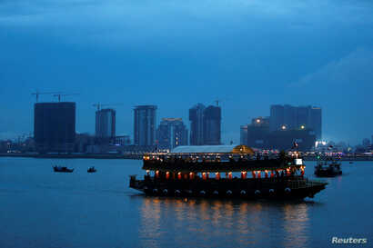 A boat passes buildings under construction on Diamond Island also known as 'Koh Pich', as seen from Tonle Chaktomuk river in Phnom Penh, Cambodia, May 22, 2018.