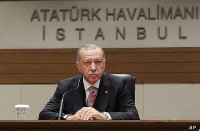 Turkey's President Recep Tayyip Erdogan talks to members of the media regarding the local elections, in Istanbul, Monday, April 8, 2019, prior to his departure for Russia.