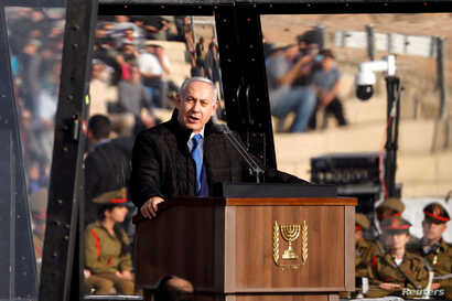 Israeli Prime Minister Benjamin Netanyahu speaks at the Israeli Air Force pilots' graduation ceremony at Hatzerim air base in southern Israel, Dec. 26, 2018.