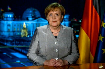 German Chancellor Angela Merkel poses for a photograph after the recording of her annual New Year's speech at the Chancellery in Berlin, Germany, Dec. 30, 2018.