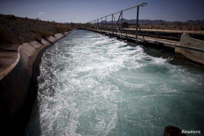 FILE - The Colorado River Aqueduct is seen in Hayfield Lake, California, May 18, 2015.