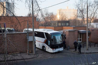 Buses believed to be carrying expelled diplomats leave the U.S. Embassy in Moscow, Russia, April 5, 2018. Russia last week ordered 60 American diplomats to leave the country by Thursday, in retaliation for the United States expelling the same number ...