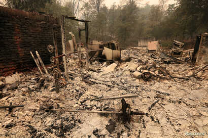 The debris of a burned home is seen after the Carr Fire west of Redding, Calif, July 28, 2018.