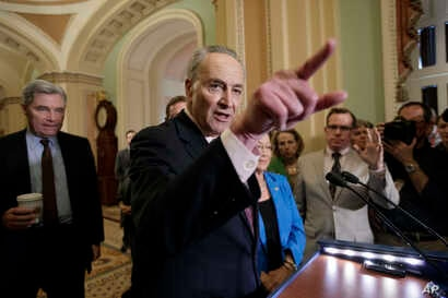 Senate Minority Leader Chuck Schumer of New York, joined by Sen. Sheldon Whitehouse, D-R.I., and Sen. Mazie Hirono, D-Hawaii, speaks to reporters on Capitol Hill in Washington about the struggle to move Supreme Court nominee Neil Gorsuch toward a fin...
