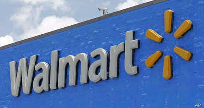 FILE - A Walmart sign is shown at a store in Hialeah Gardens, Fla., June 1, 2017.