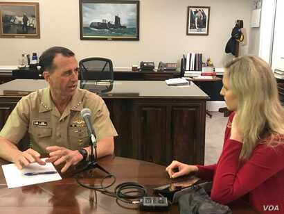 Admiral John Richardson and VOA reporter Carla Babb at the Pentagon.