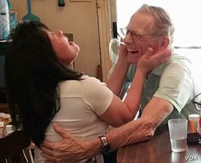 Nguyễn Thị Kim Nga, left, embraces her American father, Gary Wittig, when they met for the first time.