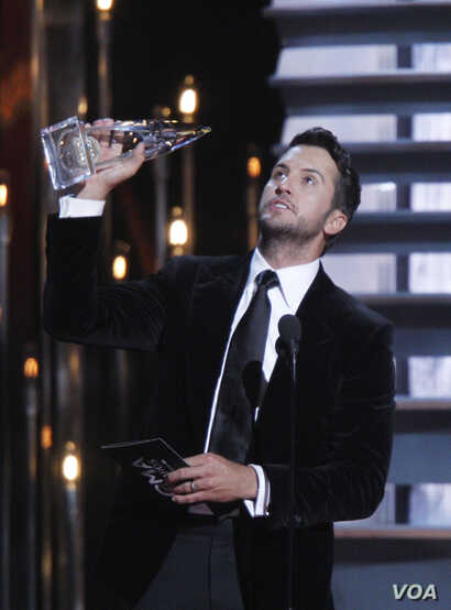 Luke Bryan accepts the award for entertainer of the year onstage at the 48th annual CMA Awards at the Bridgestone Arena, Nov. 5, 2014, in Nashville, Tenn.