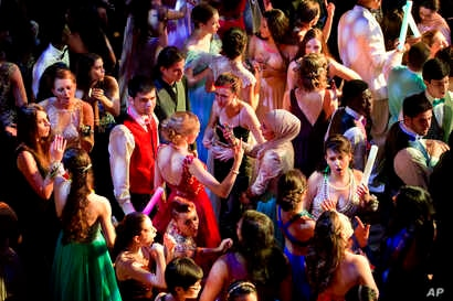 FILE - A group dances during senior prom at Northwest High School in Silver Spring, Maryland, May 13, 2016.
