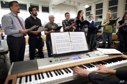 Members of the Butterfly Music Transgender Chorus rehearse at a church in Cambridge, Mass., Oct. 7, 2015. The chorus is led by Sandi Hammond, a vocal coach who also trains members how to adjust their voices safely when they transition.
