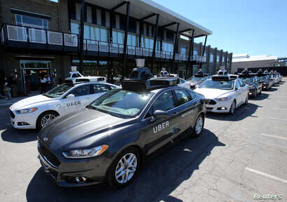 A fleet of Uber's Ford Fusion self driving cars are shown during a demonstration of self-driving automotive technology in Pittsburgh, Pennsylvania, Sept. 13, 2016.