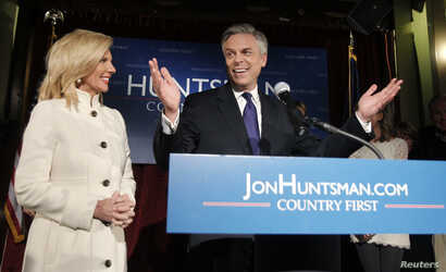 FILE - Republican presidential candidate former Utah Governor Jon Huntsman addresses supporters with his wife, Mary Kaye, at his New Hampshire primary night rally in Manchester, New Hampshire, Jan. 10, 2012.