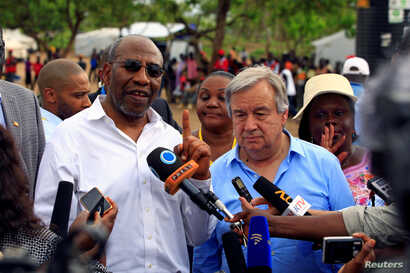 FILE - UN Secretary General Antonio Guterres (L) and Uganda's Prime Minister Ruhakana Rugunda address the media after a tour of Imvepi, where south Sudanese refugees are settled, in northern Uganda, June 22, 2017.