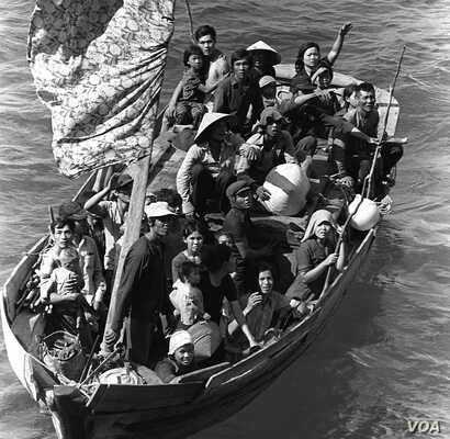 Vietnamese boat people rescued northeast of Cam Ranh Bay, Vietnam, after spending eight days at sea. 15 May 1984. (US Navy)