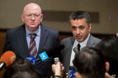 UN SRussian Ambassador to the United Nations Vassily Nebenzia (L) and Bolivian Ambassador to the United Nations Sacha Llorenty speak to reporters in after Security Council consultations of the situation in Syria, April 12, 2018, at United Nations hea...