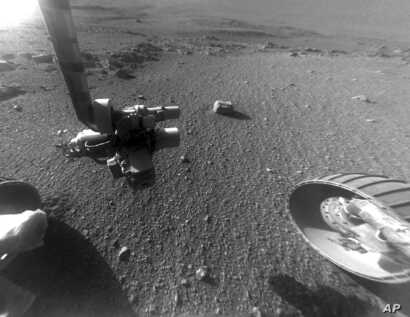 This Jan. 4, 2018 photo made available by NASA shows a view from the front Hazard Avoidance Camera of the Opportunity rover on the inboard slope of the western rim of Endeavour Crater on the planet Mars.