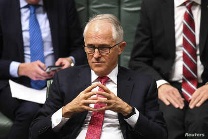 Australian Prime Minister Malcolm Turnbull reacts during House of Representatives Question Time at Parliament House in Canberra, Australia, Aug. 21, 2018.