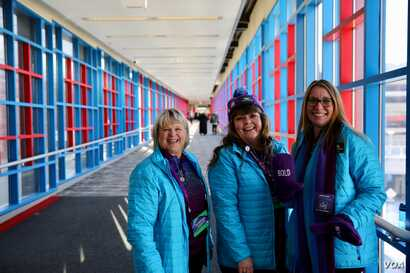 Sharri Murphy poses with other local volunteers who are helping to guide visitors through the elaborate downtown Skyway. (B. Allen/VOA)