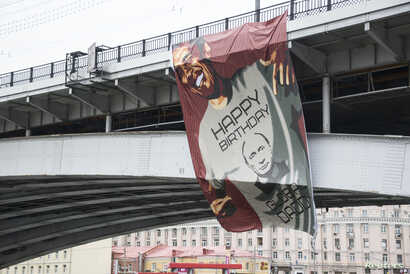 FILE - A huge banner depicting U.S. President Barack Obama wearing a T-shirt wishing Russia's President Vladimir Putin a happy birthday, hangs on a bridge in Moscow, Oct. 7, 2014.