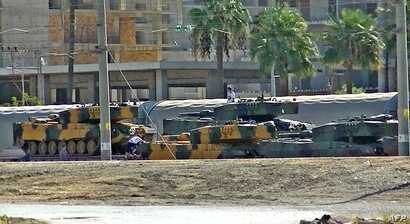 Turkish tanks arrive at the Iskenderun train port, Oct. 7, 2017. at Iskenderun district in Turkey's Hatay province. Turkish President Recep Tayyip Erdogan said Saturday that pro-Ankara Syrian rebels were staging a new military operation in Syria's ji...