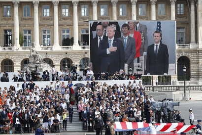 FILE - President Donald Trump and French President Emmanuel Macron during Bastille Day parade on the Champs Elysees avenue in Paris, July 14, 2017.