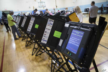 FILE - An electronic voting machine in Columbus, Ohio, Nov. 3, 2015. Democrats and Republicans compete in primaries and caucuses in at least 11 states and one U.S. territory on Tuesday.