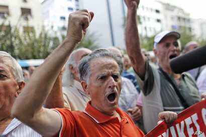 A pensioner shouts slogans during an anti-austerity protest in front of the EU headquarters in Athens, Monday, Oct. 8, 2012.