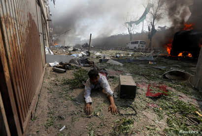 A wounded man lies on the ground at the site of a blast in Kabul, Afghanistan May 31, 2017.
