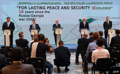 Jacek Czaputowicz (2-R) and Latvia's Foreign Minister Edgars Rinkevics (R) hold a briefing following a round table meeting in Tbilisi, Georgia, on August 7, 2018, a day ahead of the 10th anniversary of the start of the brief war between Russia and Ge...