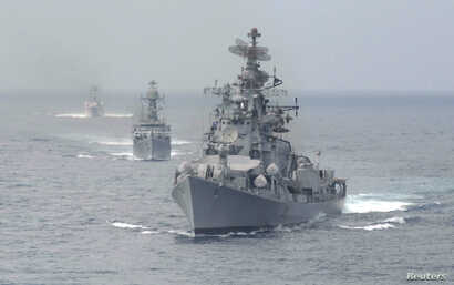FILE - Indian naval warships are seen in the waters off the southern Indian port of Chennai.