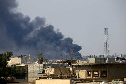 Smoke rises from from the old city during a battle against Islamic State militants, in Mosul, Iraq March, March 24, 2017.