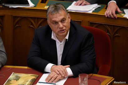 FILE - Hungarian Prime Minister Viktor Orban sits before vote on the 'Stop Soros' package of bills that criminalises some help given to illegal immigrants at the Parliament in Budapest, Hungary, June 20, 2018.