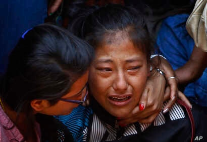 A relative of one of the Nepalese climbers killed in an avalanche on Mount Everest cries during the funeral ceremony in Katmandu, Nepal, April 21, 2014.