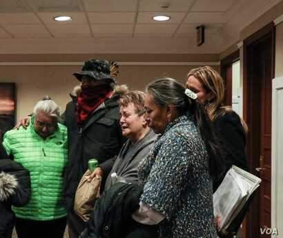 A tearful Barbara Charbonneau-Dahlen, with supporters and family members, reacting to a S.D. Senate vote to uphold current statute of limitations on sex abuse cases, February 13, 2018.
