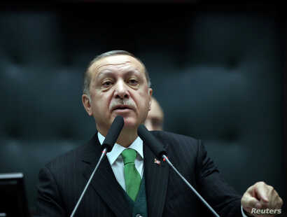 Turkey's President Tayyip Erdogan addresses members of parliament from his ruling AK Party during a meeting at the Turkish parliament in Ankara, Turkey, January 16, 2018.